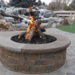Outdoor Fire Pit with Logs and Putting Green